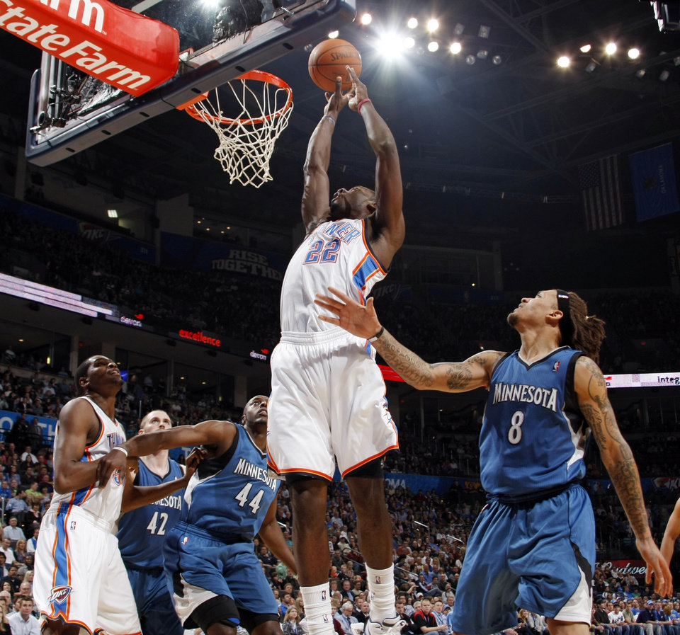 Oklahoma City\'s Jeff Green (22) takes a shot near Kevin Love (42), Anthony Tolliver (44) and Michael Beasley (8) of Minnesota as well as teammate Kevin Durant (35) during the NBA basketball game between the Minnesota Timberwolves and the Oklahoma City Thunder at the Oklahoma City Arena, Monday, November 22, 2010, in Oklahoma City. Photo by Nate Billings, The Oklahoman