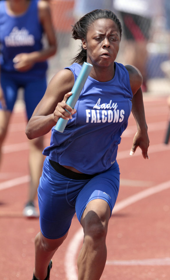 Photo - Millwood Falcon runner Apryl Williams taks the handoff for her leg as the Falcons win the girls 4x200 at the 3A and 4A state championship track meet on Saturday, May 5, 2012, in Ardmore, Okla.  Photo by Steve Sisney, The Oklahoman