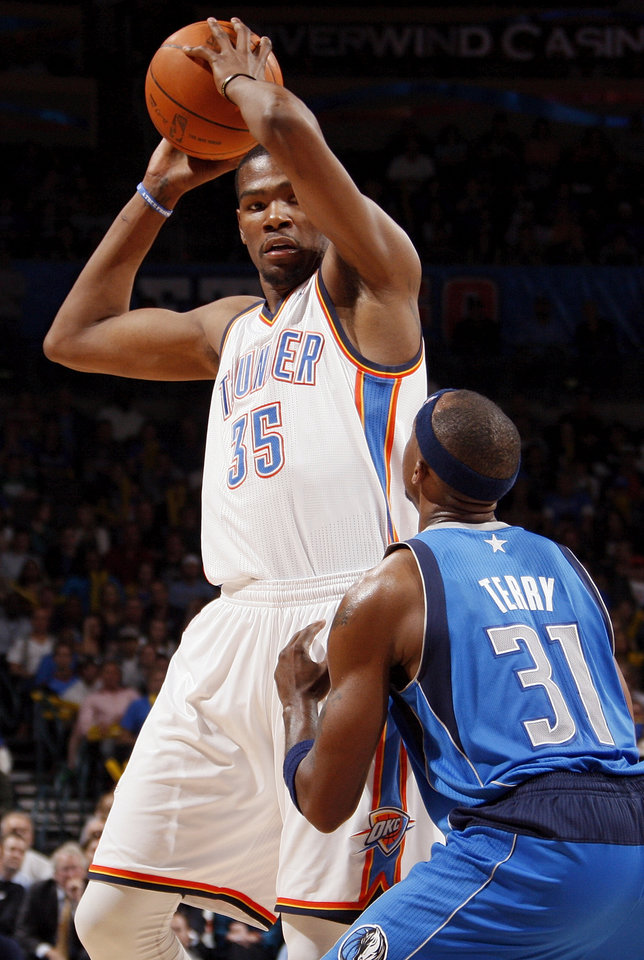 Oklahoma City\'s Kevin Durant (35) keeps the ball away from Dallas\' Jason Terry (31) during the NBA basketball game between the Oklahoma City Thunder and the Dallas Mavericks at Chesapeake Energy Arena in Oklahoma City, Monday, March 5, 2012. The Thunder won, 95-91. Photo by Nate Billings, The Oklahoman