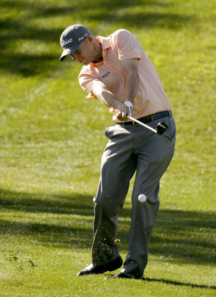 Photo - Bill Haas hits from the rough on the second hole during the third round of the Humana Challenge golf tournament on the Palmer Private course at PGA West Saturday, Jan. 18, 2014, in La Quinta, Calif. (AP Photo/Chris Carlson)