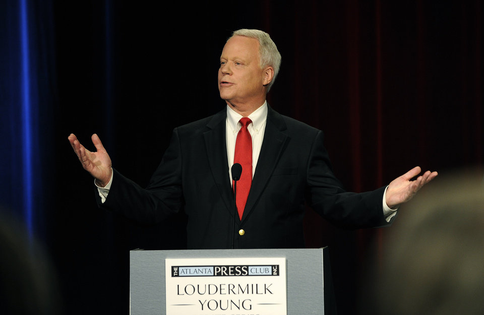 Photo - Republican Senatorial candidate Rep. Paul Broun of Athens, Ga., discusses his policies during a debate at the Georgia Public Broadcasting studio, Sunday, May 11, 2014, in Atlanta. (AP Photo/David Tulis)
