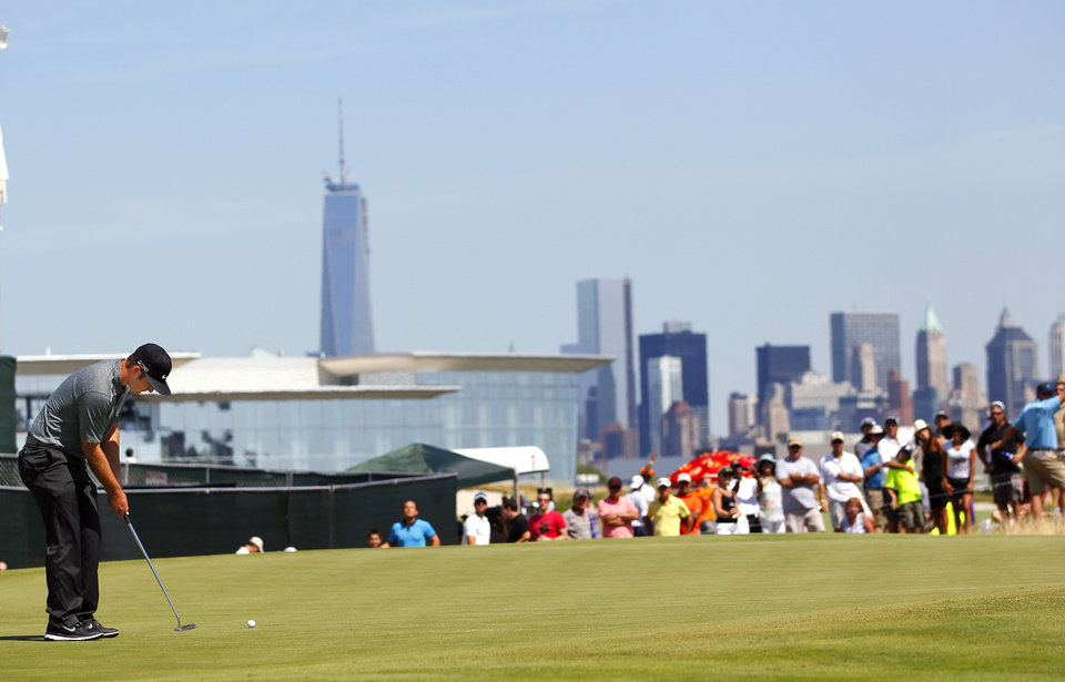 Photo - Kevin Chappell putts on the second green during the final round of The Barclays golf tournament on Sunday, Aug. 25, 2013, in Jersey City, N.J. (AP Photo/Rich Schultz)