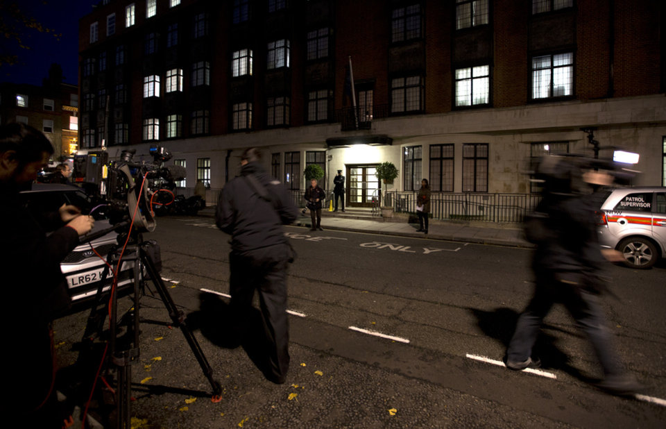 "Members of the media position themselves, as a policeman stands guard outside the King Edward VII hospital where the Duchess of Cambridge has been admitted with a severe form of morning sickness,  in London, Monday, Dec.  3, 2012. Prince William and his wife Kate are expecting their first child. St. James's Palace announced the pregnancy Monday, saying that the Duchess of Cambridge — formerly known as Kate Middleton — has a severe form of morning sickness and is currently in a London hospital. William is at his wife's side. The palace said since the pregnancy is in its ""very early stages,"" the 30-year-old duchess is expected to stay in the hospital for several days and will require a period of rest afterward. (AP Photo/Alastair Grant)"