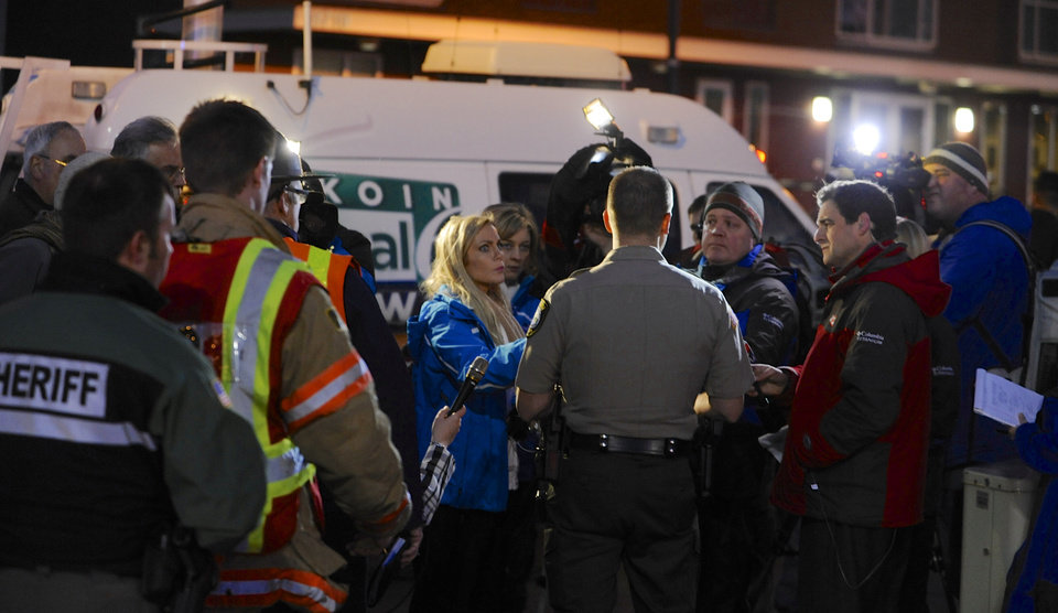 CORRECTS MALL LOCATION - Media gather around Clackamas County sheriff\'s Lt. James Rhodes during a news conference at the scene of a multiple shooting at Clackamas Town Center Mall in Portland, Ore., Tuesday Dec. 11, 2012. A gunman is dead after opening fire in the Portland, Ore., area shopping mall Tuesday, killing two people and wounding another, sheriff\'s deputies said. (AP Photo/Greg Wahl-Stephens)