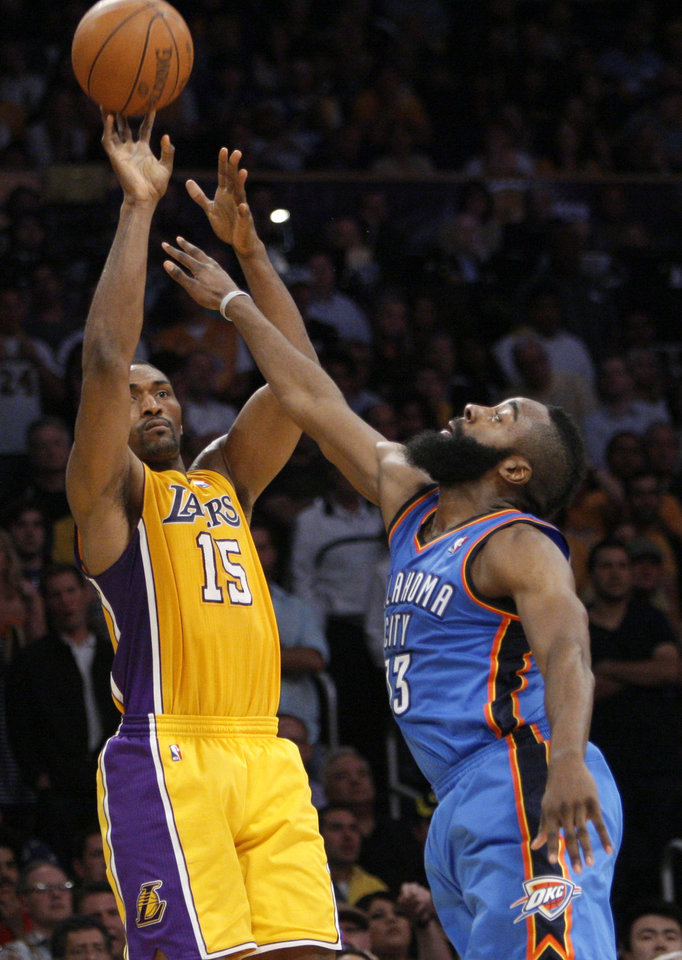 Oklahoma City's James Harden (13) defends against Los Angeles' Metta World Peace (15) during Game 4 in the second round of the NBA basketball playoffs between the L.A. Lakers and the Oklahoma City Thunder at the Staples Center in Los Angeles, Saturday, May 19, 2012. Photo by Nate Billings, The Oklahoman