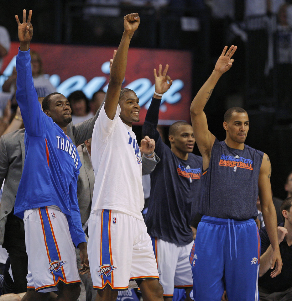 Photo - Oklahoma City's Serge Ibaka (9), Kevin Durant (35), Russell Westbrook (0), and Thabo Sefolosha (2) react during game five of the Western Conference semifinals between the Memphis Grizzlies and the Oklahoma City Thunder in the NBA basketball playoffs at Oklahoma City Arena in Oklahoma City, Wednesday, May 11, 2011. Photo by Bryan Terry, The Oklahoman