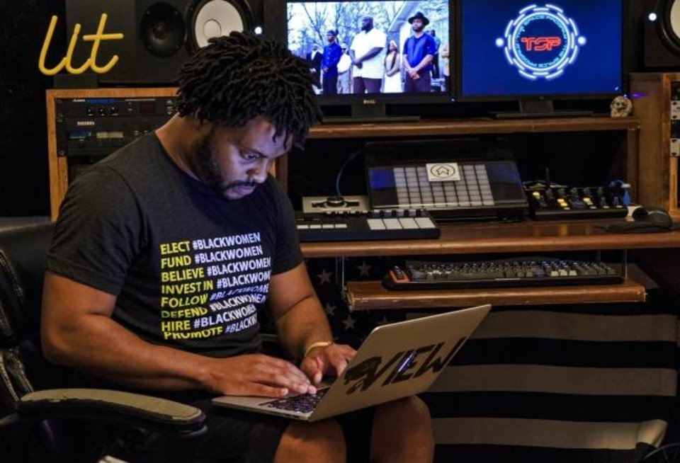 Photo - Stevie Johnson, a University of Oklahoma doctoral candidate and hip hop producer, speaks the album and videos he created as part of his