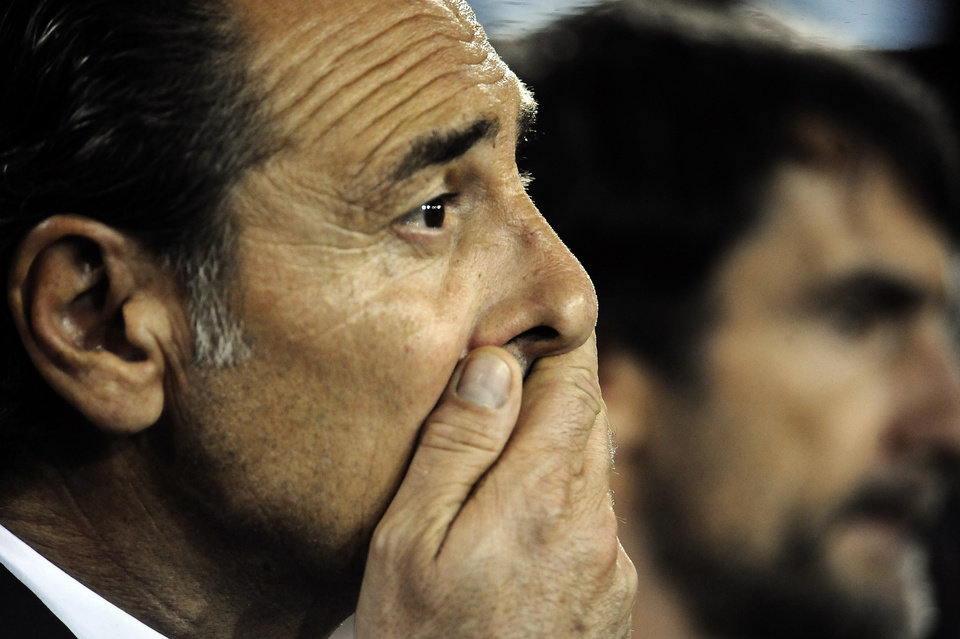Photo - Italy coach Cesare Prandelli watches a World Cup, Group B, qualification match between Italy and Armenia in Naples, Italy, Tuesday, Oct. 15, 2013. The game ended in a 2-2 draw. (AP Photo/Salvatore Laporta)