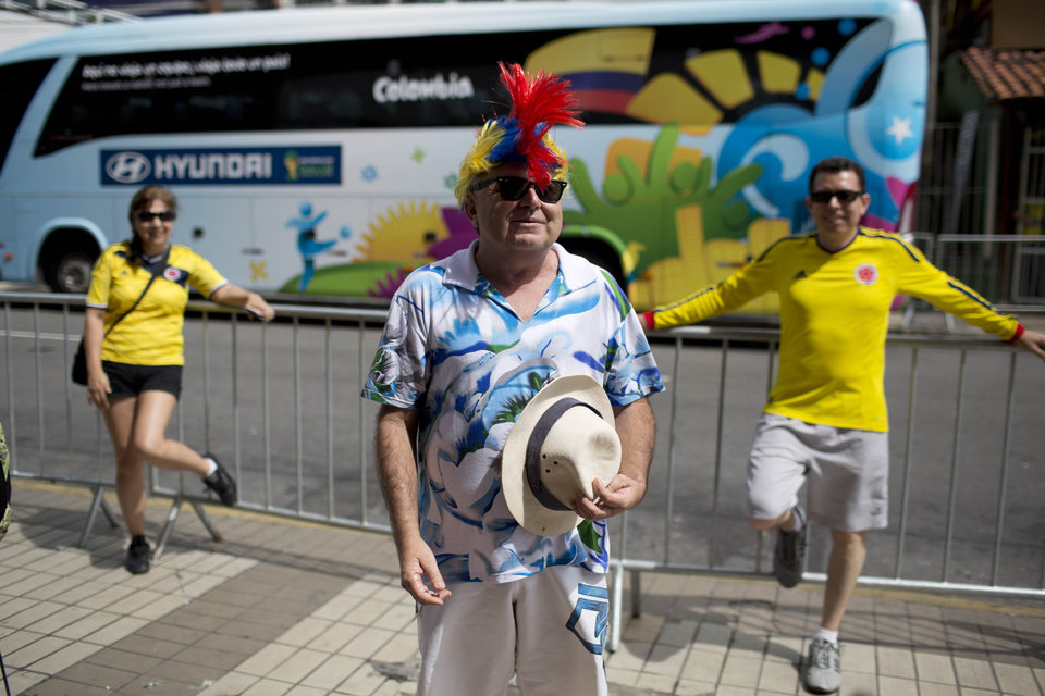 Photo - A fan of the Colombian national soccer team holds a pose, as his friend makes a picture of him in front of the hotel where the Colombian team is lodging in Fortaleza, Brazil, Thursday, July 3, 2014. Colombian supporters are in Fortaleza hoping to see some history being made in this northeastern World Cup city where Brazil and Colombia face off in the World Cup quarterfinals, Saturday. (AP Photo/Rodrigo Abd)
