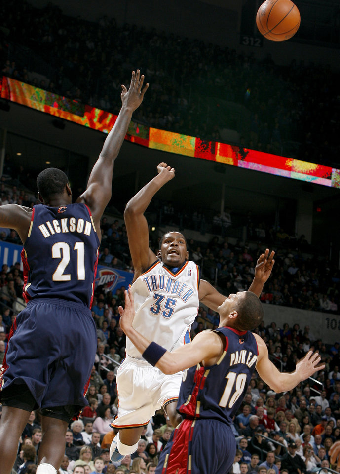 Photo - Oklahoma Cit's Kevin Durant (35) looses the ball as Cleveland's J.J. Hickson (21) and Anthony Parker (18) defend him during the NBA game between the Oklahoma City Thunder and the Cleveland Cavaliers, Sunday, Dec. 13, 2009, at the Ford Center in Oklahoma City. Photo by Sarah Phipps, The Oklahoman