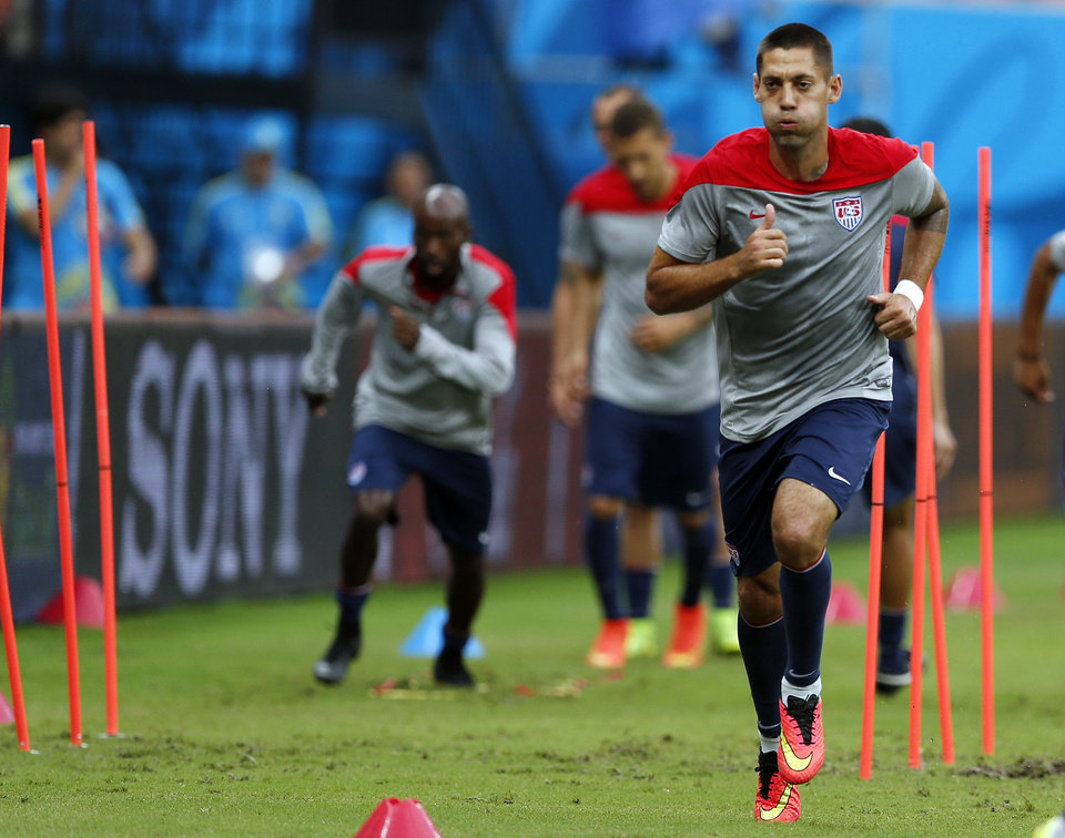 Photo - United States' Clint Dempsey works out during a training session at the Arena da Amazonia in Manaus, Brazil, Sunday, June 22, 2014. The U.S. will play Portugal in group G of the 2014 soccer World Cup on June 22. (AP Photo/Paulo Duarte)