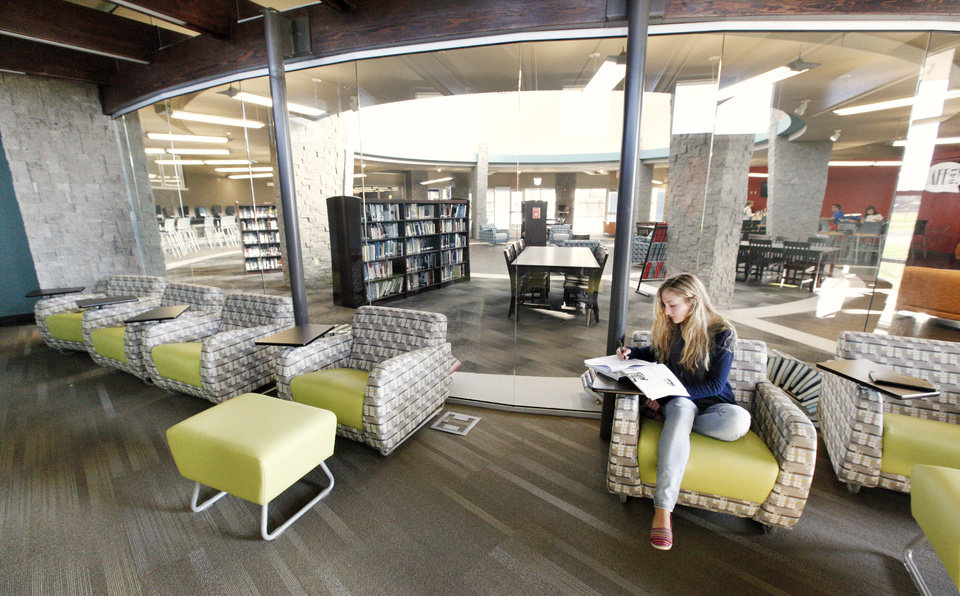 Photo - Jenny Snyder, 17, uses the study room in the new media center at Deer Creek High School.  Photos by Paul B. Southerland, The Oklahoman
