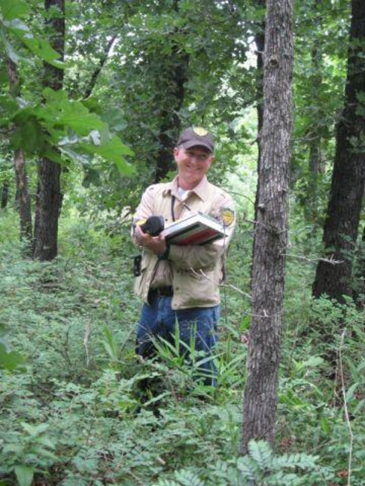 Photo - George Geissler, Oklahoma Forestry Services forester, takes tree measurements.  PHOTO PROVIDED - PHOTO PROVIDED