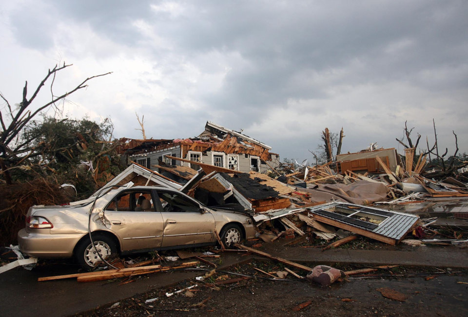 Photo - A home and car in the Forest Lake neighborhood of Tuscaloosa, Ala. are destroyed after a tornado ripped through Wednesday, April 27, 2011.  A wave of severe storms laced with tornadoes strafed the South on Wednesday, killing at least 16 people around the region and splintering buildings across swaths of an Alabama university town. (AP Photo/The Tuscaloosa News, Michelle Lepianka Carter)