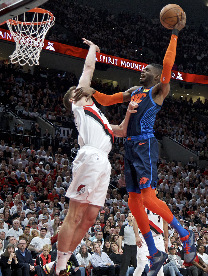 Photo - Oklahoma City Thunder forward Nerlens Noel, right, shoots over Portland Trail Blazers forward Meyers Leonard during the first half of Game 5 of an NBA basketball first-round playoff series, Tuesday, April 23, 2019, in Portland, Ore. (AP Photo/Craig Mitchelldyer)