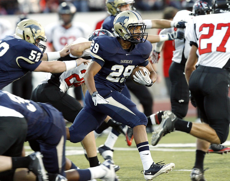 Photo - Southmoore's Johnathan Martin takes the ball downfield during their high school football game at Moore Stadium in Moore, Oklahoma on Friday, September 9, 2011. Photo by John Clanton, The Oklahoman