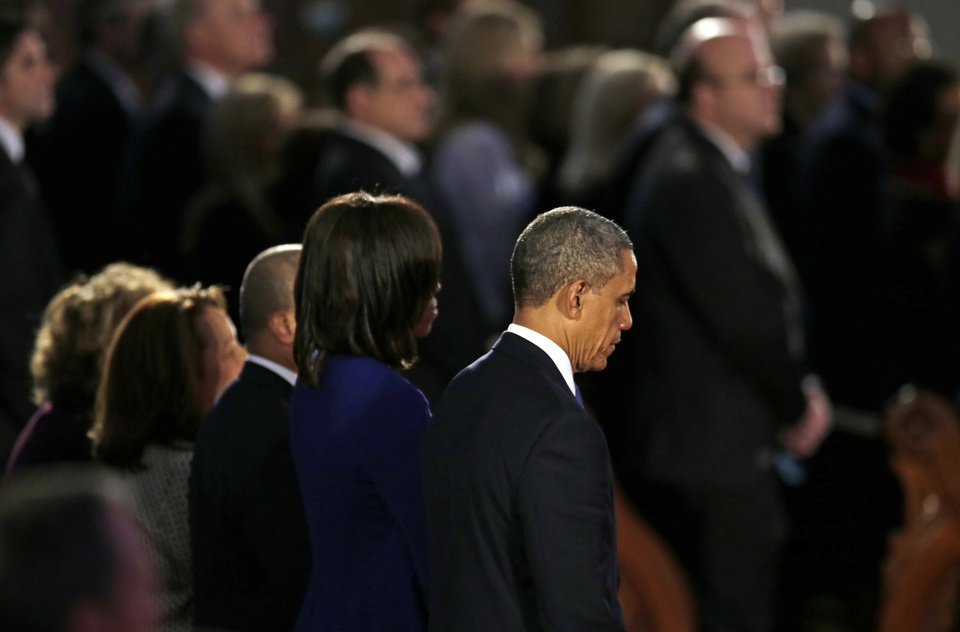 President Barack Obama and first lady Michelle Obama attend an interfaith healing service at the Cathedral of the Holy Cross in Boston, Thursday, April 18, 2013, for victims of Monday's Boston Marathon explosions. (AP Photo/Charles Krupa)