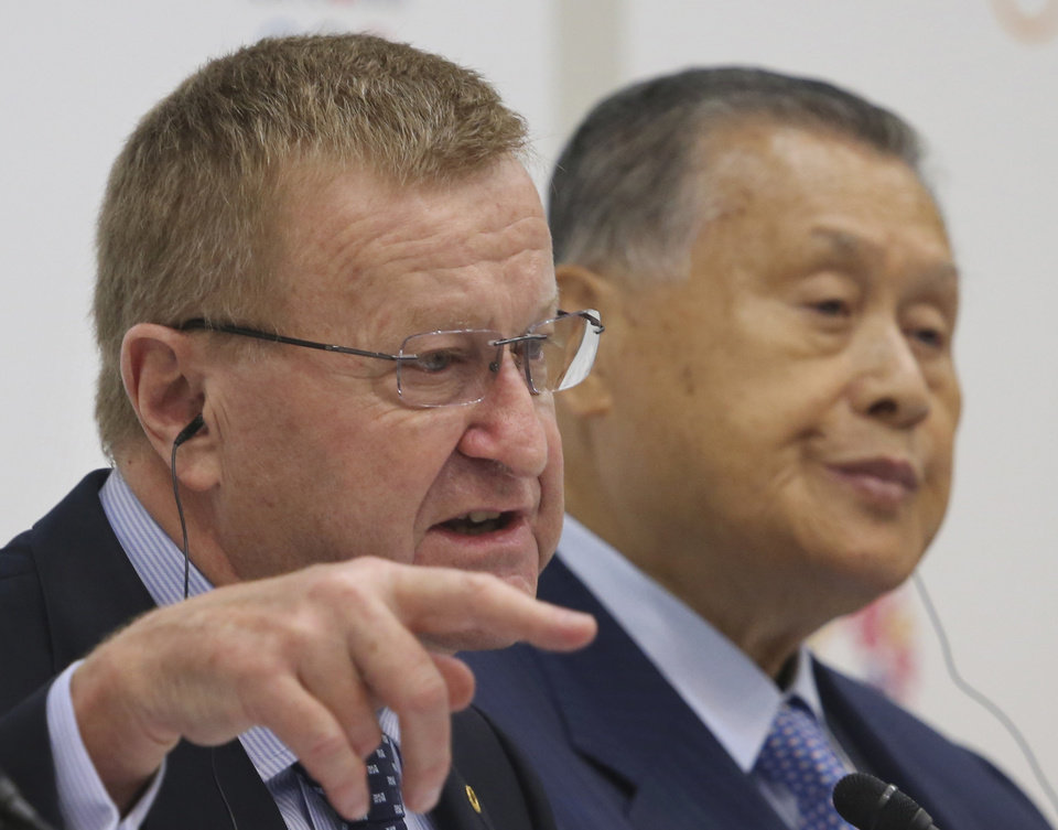 Photo - IOC Vice President John Coates speaks as Yoshiro Mori, right, president of the Tokyo Organizing Committee of the Olympic and Paralympic Games, listens during a press conference after the first coordination commission meeting for the Tokyo 2020 Games, in Tokyo Friday, June 27, 2014. The IOC wrapped up its first coordination commission meeting on Friday, saying any changes to the venue plan should not alter the core principles of the city's winning bid. Japanese Olympic organizers are reviewing their venue plans because of concerns over costs and have suggested some venues may have to be moved. (AP Photo/Koji Sasahara)