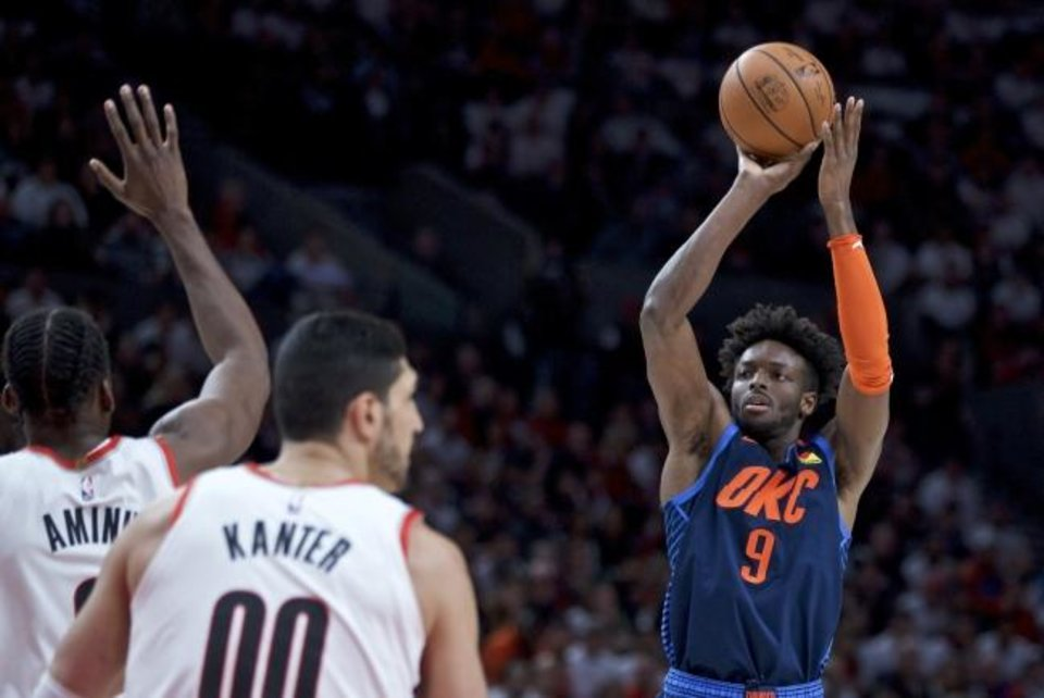 Photo -  Oklahoma City Thunder forward Jerami Grant, right, made some big shots in the second half, but it wasn't enough. Portland eliminated OKC from the playoffs with a Game 5 victory at the Moda Center. [AP Photo/Craig Mitchelldyer]