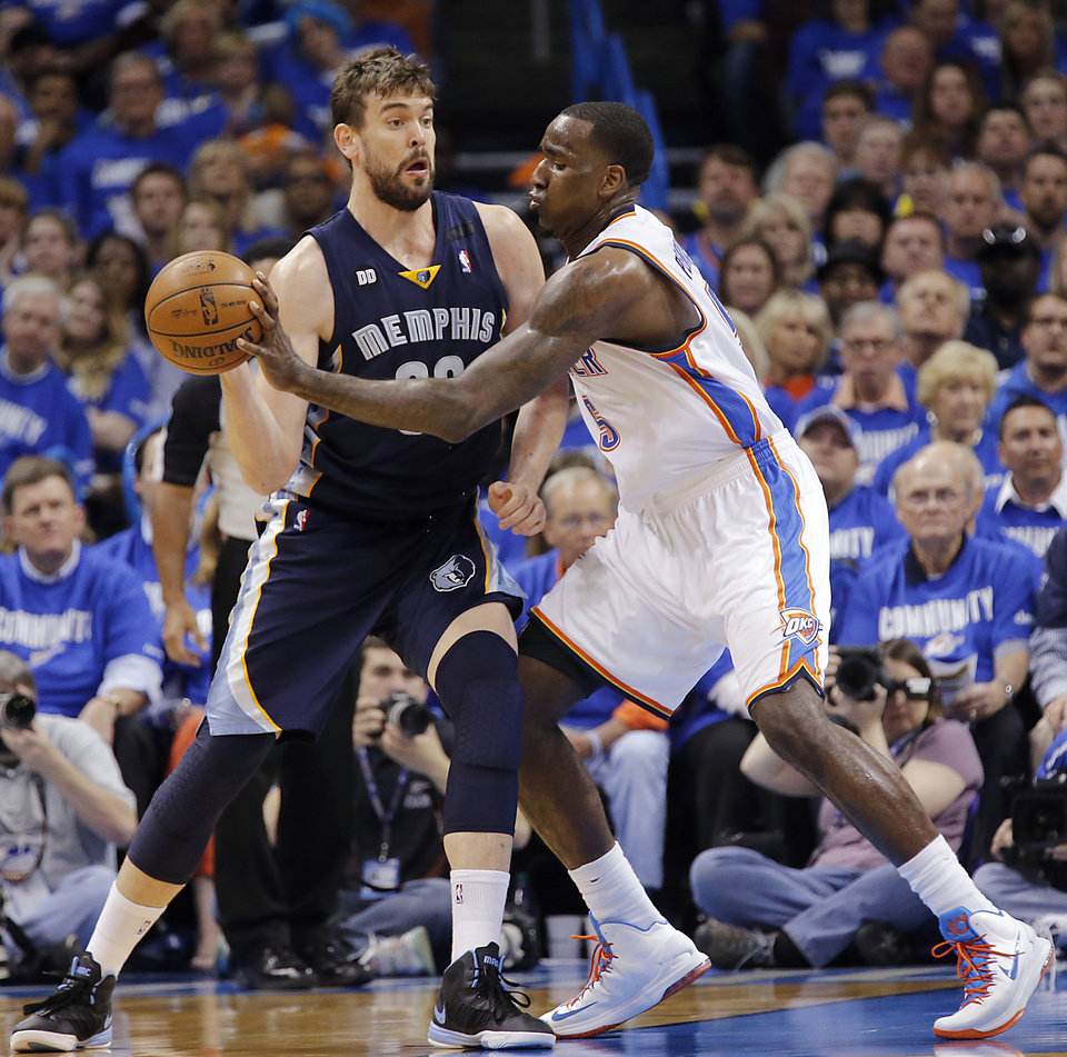 Oklahoma City\'s Kendrick Perkins (5) defends on Memphis\' Marc Gasol (33) during the second round NBA playoff basketball game between the Oklahoma City Thunder and the Memphis Grizzlies at Chesapeake Energy Arena in Oklahoma City, Sunday, May 5, 2013. Photo by Chris Landsberger, The Oklahoman