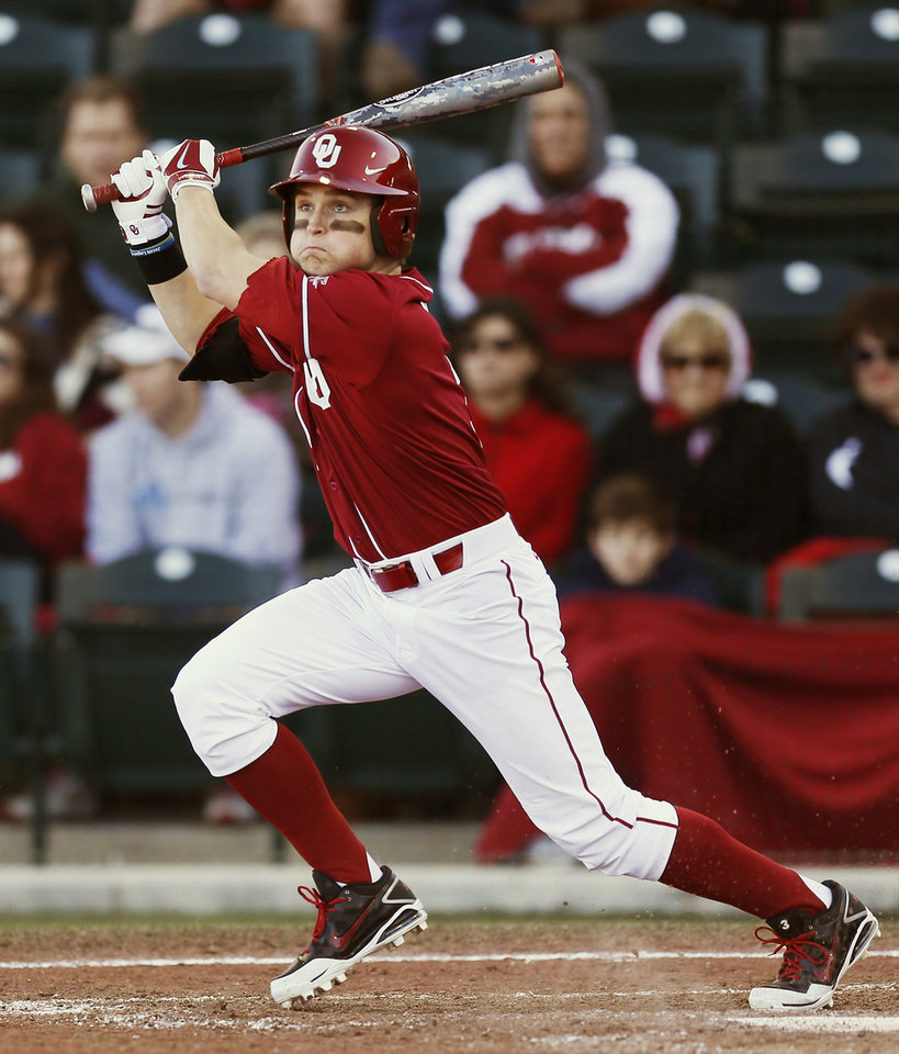 Photo - Oklahoma's Craig Aikin (3) drives in a run in the fifth inning during OU's season-opening college baseball game against Seton Hall at L. Dale Mitchell Park in Norman,  Okla., Friday, Feb. 14, 2014. Photo by Nate Billings, The Oklahoman