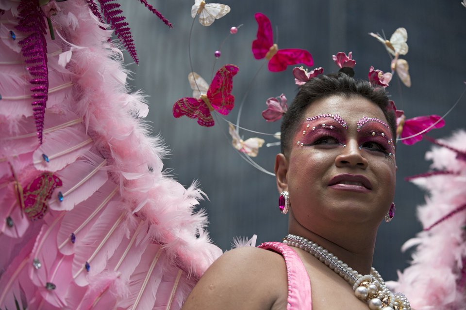 Photo - A man wears a costume during Mexico City's annual gay pride parade, Saturday, June 28, 2014. Thousands of people supporting the rights of gays, lesbians, bisexuals, and transgenders marched through the streets of central Mexico City Saturday, many waving rainbow flags or wearing intricate costumes. Gay marriage is legal within Mexico City. (AP Photo/Rebecca Blackwell)