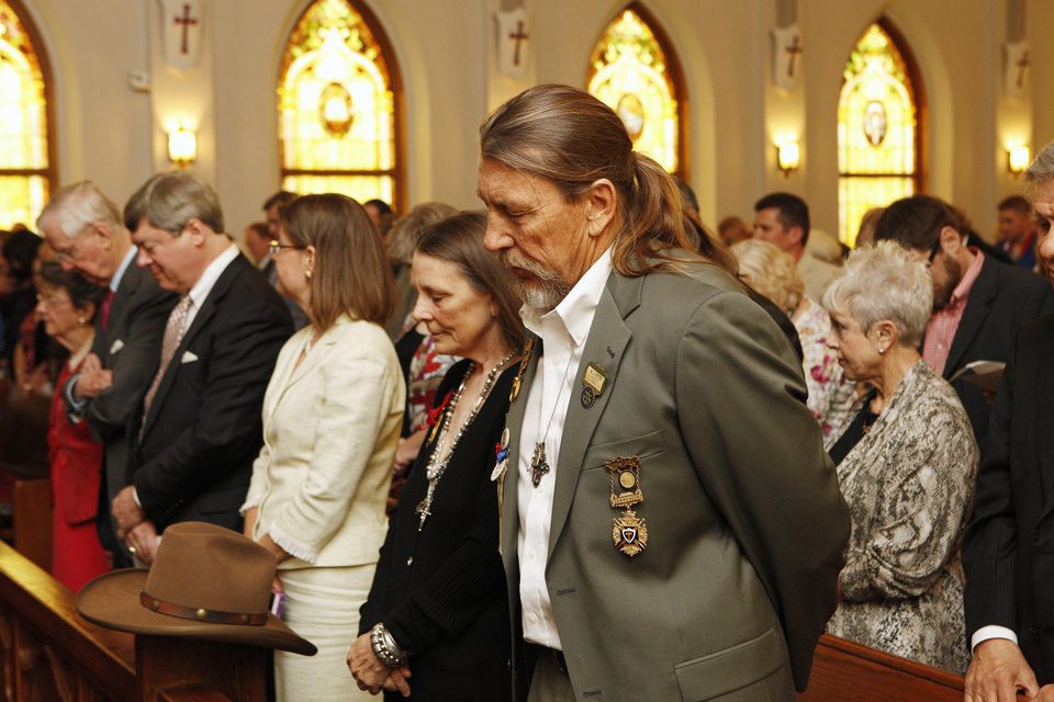 Thomas Fugitt, center, Okla. City, bows his head as a prayer is given before the opening of the Century Chest at First Lutheran Church in Oklahoma City Monday, April 22, 2013. The Century Chest is a time capsule put together and buried April 22, 1913 by the church. Fugitt's great grandfather made the land run of 1889. Photo by Paul B. Southerland, The Oklahoman