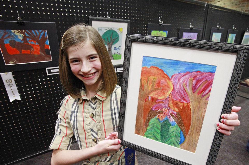 Russell Dougherty fifth-grader Olivia Scott poses with her first place-winning tree art at Edmond's celebration of Arbor Week at the Edmond Library, March 26, 2012.  Photo By David McDaniel/The Oklahoman