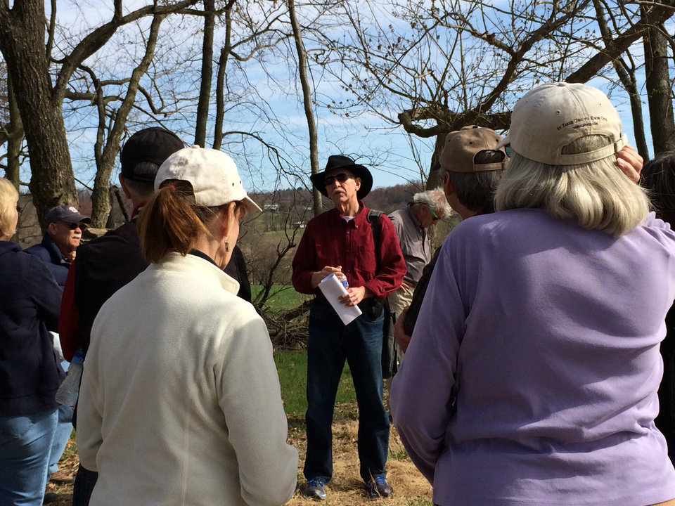 Photo - In this Sunday, April 6, 2014 photo, Keith White, center, leads a group of friends on a tour of the Monocacy National Battlefield south of Frederick, Md. The battle, which took place on July 9, 1864, is credited with delaying the Confederate move toward Washington, D.C. There are more than 300 miles of trails to explore in the 24 national parks designated as sites of significant Civil War battles. (AP Photo/Carole Feldman)