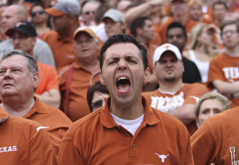 Photo -   A Texas fan yells during the first half of an NCAA college football game against Oklahoma at the Cotton Bowl Saturday, Oct. 13, 2012, in Dallas. (AP Photo/Michael Mulvey)