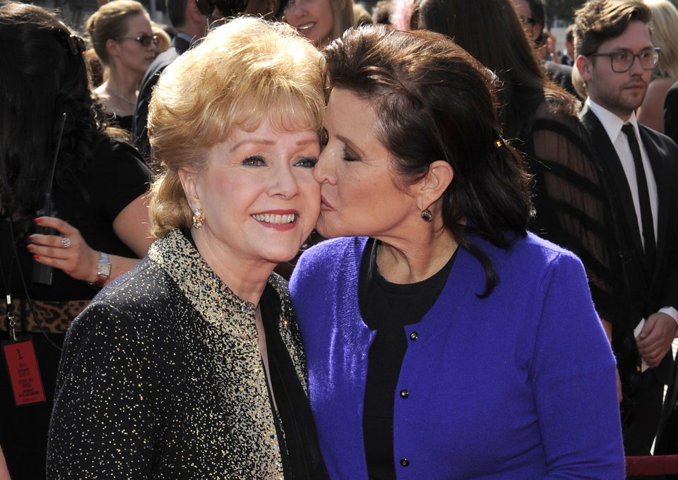 "Photo - FILE- In this Sept. 10, 2011, file photo, Debbie Reynolds, left, and Carrie Fisher arrive at the Primetime Creative Arts Emmy Awards in Los Angeles. Reynolds, star of the 1952 classic ""Singin' in the Rain"" died Wednesday, Dec. 28, 2016, according to her son Todd Fisher. She was 84. (AP Photo/Chris Pizzello, File)"