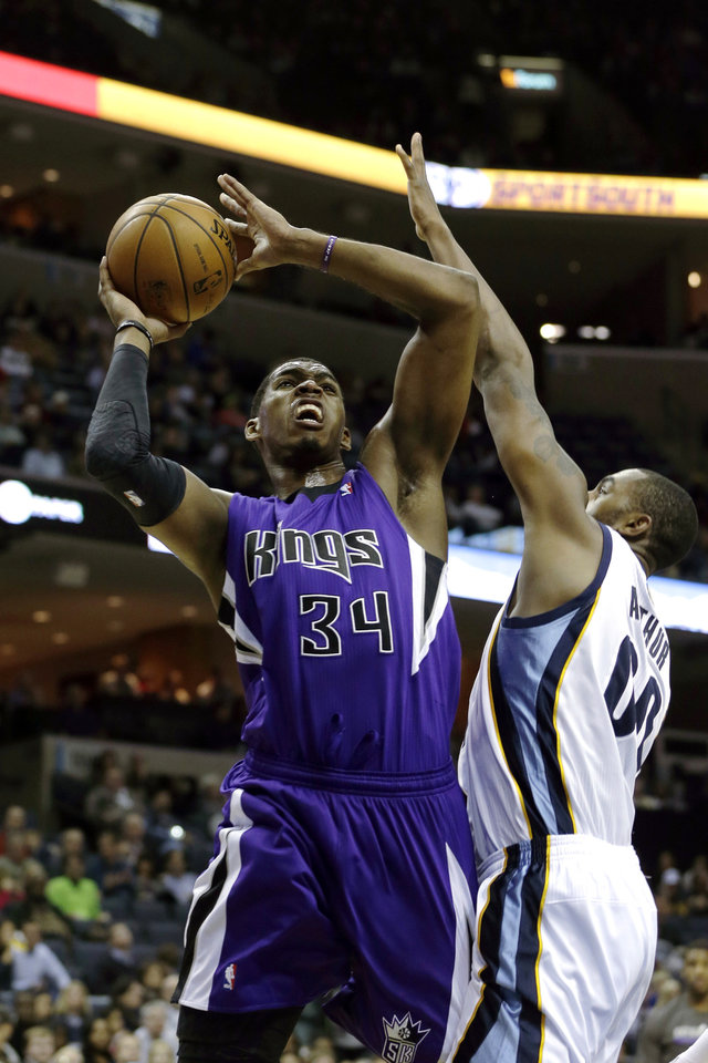 Sacramento Kings' Jason Thompson (34) shoots over Memphis Grizzlies' Darrell Arthur (00) during the first half of an NBA basketball game in Memphis, Tenn., Friday, Jan. 18, 2013. (AP Photo/Danny Johnston)