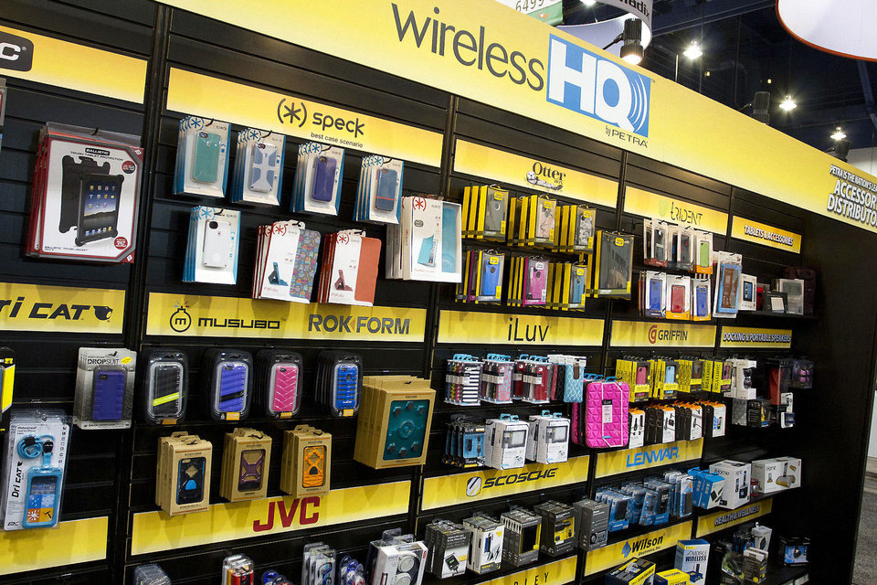 Wireless HQ accessories distributed by Edmond-based Petra Industries are displayed Wednesday at the 2013 International CES show in Las Vegas.