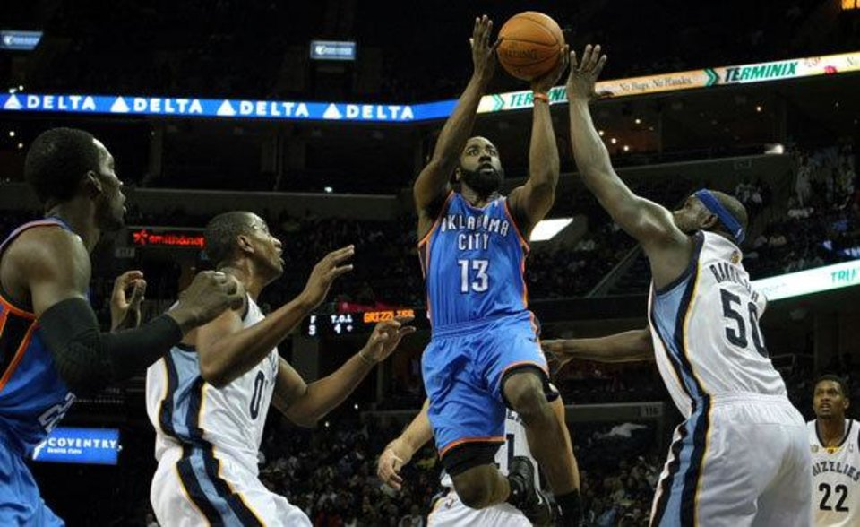 Oklahoma City Thunder guard James Harden (13) shoots under pressure by Memphis Grizzlies forward Zach Randolph (50) and forward Darrell Arthur (00) in the first half of an NBA basketball game Tuesday, Jan. 4, 2011 in Memphis, Tenn. (AP Photo/Jim Weber)