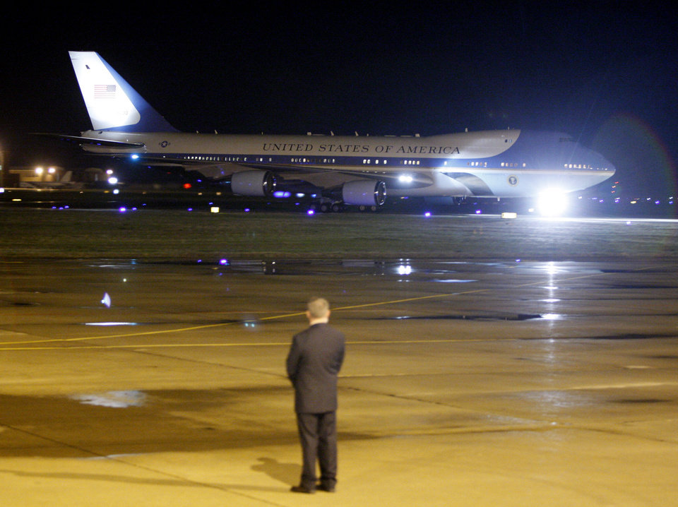 Photo - Carrying President Barack Obama, Air Force One arrives at Tinker Air Force Base in Midwest City, Wednesday, March 21, 2012. President Obama is in town for a visit to Cushing, Okla., on Thursday. Photo by Bryan Terry, The Oklahoman