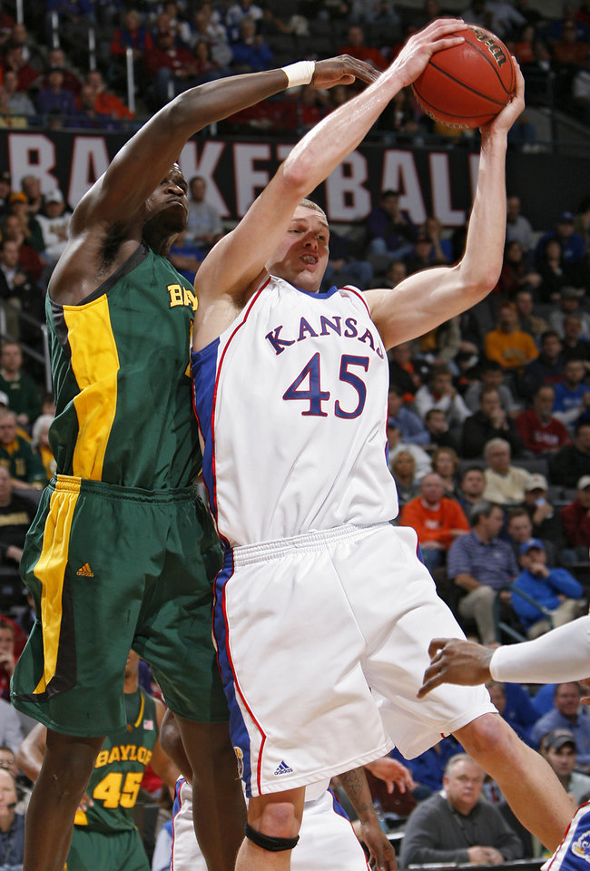 Photo - BIG 12 TOURNAMENT / COLLEGE BASKETBALL: Kansas' Cole Aldrich (45) battles under the basket against Baylor's Mamadou Diene (15) in the second round game of the Big 12 Men's Basketball Championships between The University of Kansas and The University of Baylor at the Ford Center on  Thursday, March 12, 2009, in Oklahoma City, Okla.  PHOTO BY CHRIS LANDSBERGER, THE OKLAHOMAN  ORG XMIT: KOD
