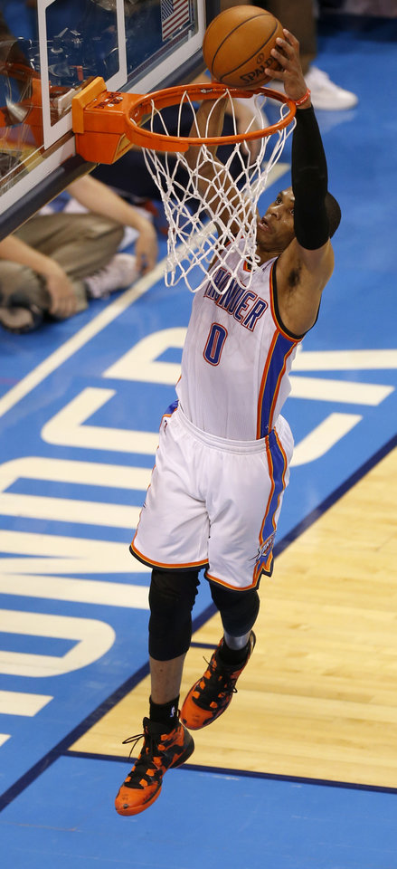Photo - Oklahoma City's Russell Westbrook (0) dunks the ball to force overtime during Game 5 in the first round of the NBA playoffs between the Oklahoma City Thunder and the Memphis Grizzlies at Chesapeake Energy Arena in Oklahoma City, Tuesday, April 29, 2014. Photo by Nate Billings, The Oklahoman