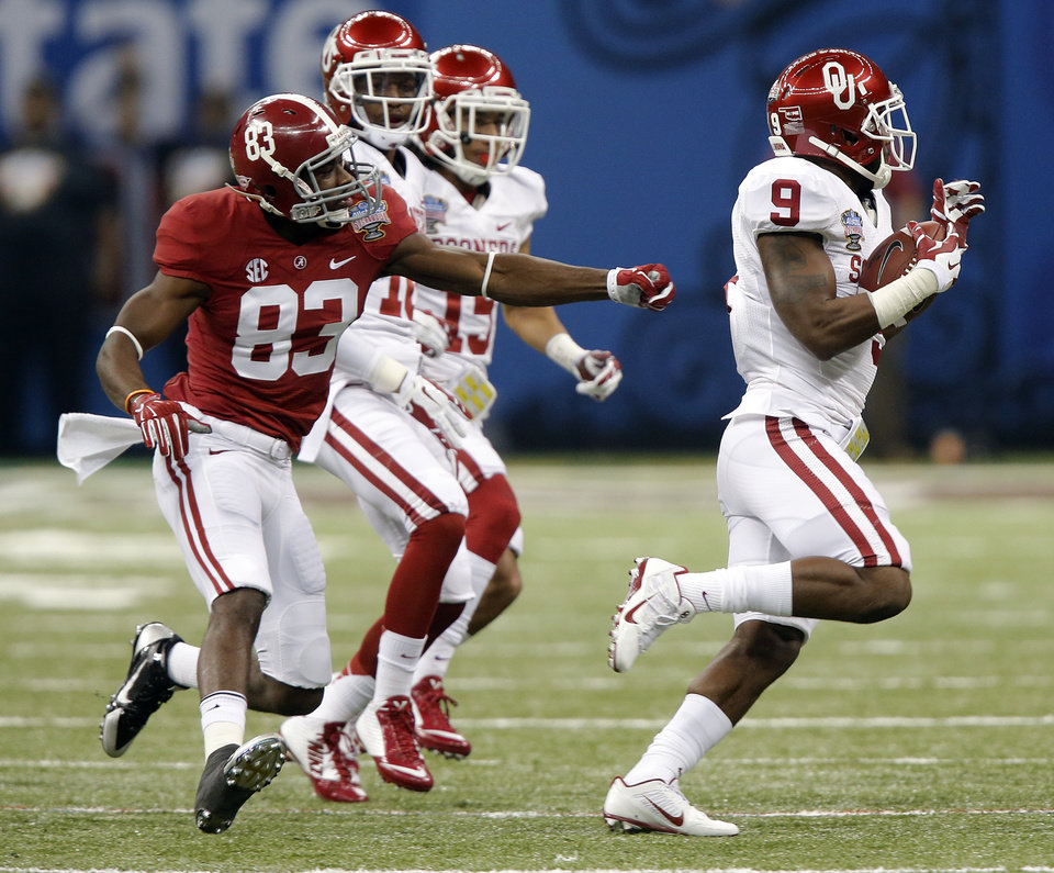 Oklahoma's Gabe Lynn (9) makes an interception on a pass intended for Alabama's Kevin Norwood (83) during the NCAA football BCS Sugar Bowl game between the University of Oklahoma Sooners (OU) and the University of Alabama Crimson Tide (UA) at the Superdome in New Orleans, La., Thursday, Jan. 2, 2014.  .Photo by Chris Landsberger, The Oklahoman