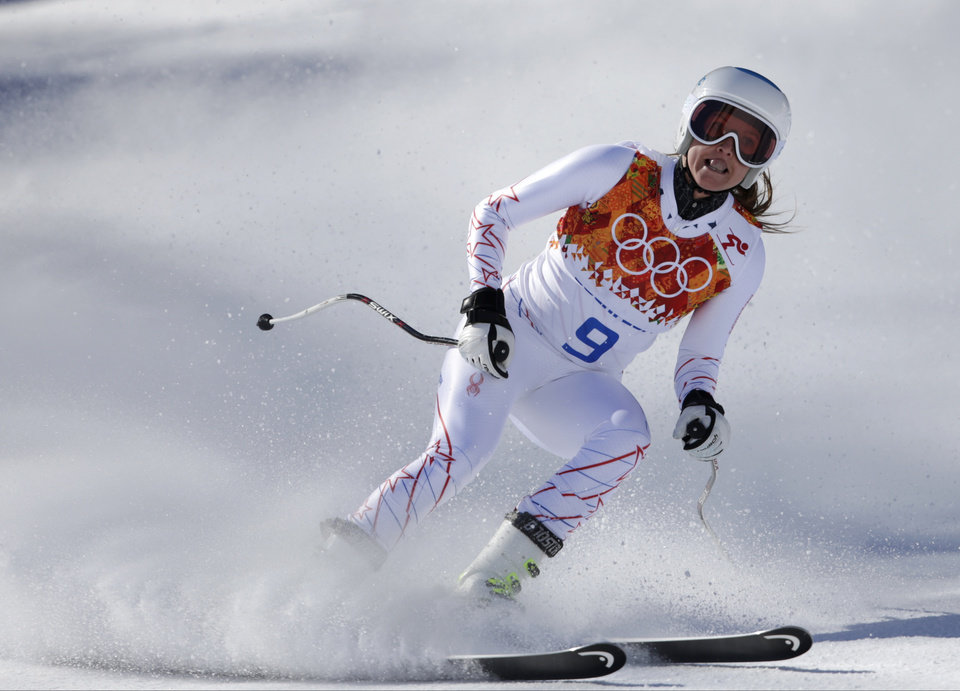 Photo - United States' Julia Mancuso arrives in the finish area during a women's downhill training run at the Sochi 2014 Winter Olympics, Thursday, Feb. 6, 2014, in Krasnaya Polyana, Russia.(AP Photo/Gero Breloer)
