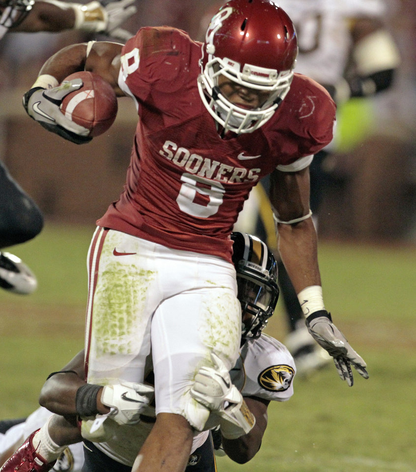 Photo - Oklahoma's Dominique Whaley (8) is brought donw by Missouri's Ian Simon (11) during the second half of the college football game between the University of Oklahoma Sooners (OU) and the University of Missouri Tigers (MU) at the Gaylord Family-Memorial Stadium on Saturday, Sept. 24, 2011, in Norman, Okla. Photo by Steve Sisney, The Oklahoman