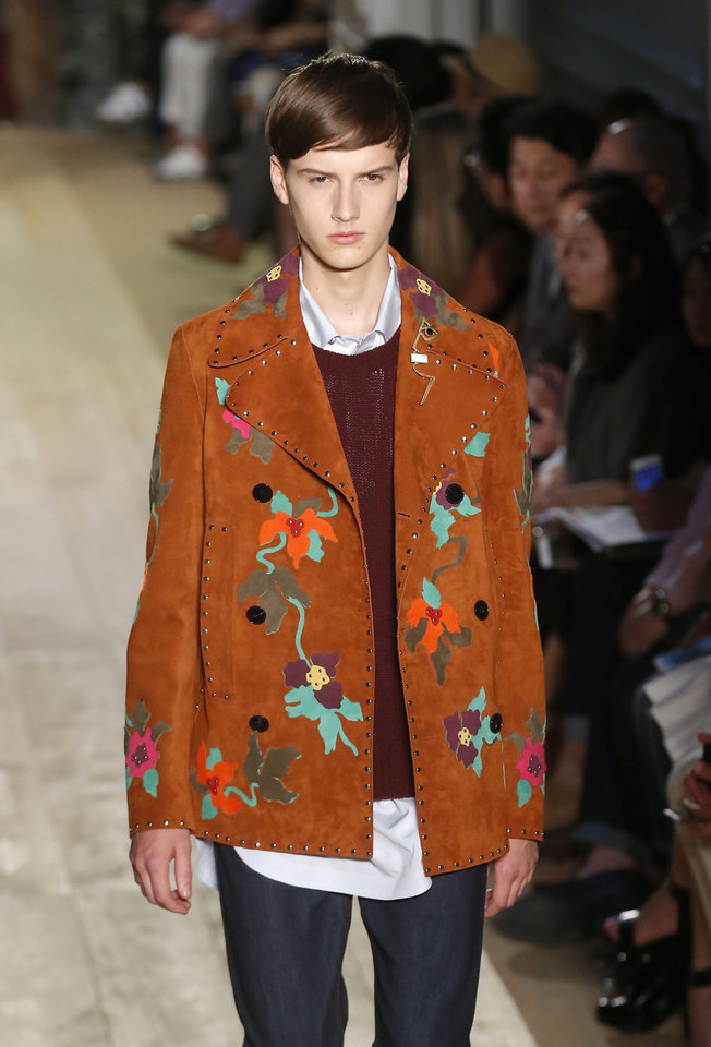 Photo - A model wears a creation as part of Valentino men's Spring-Summer 2015 fashion collection, presented in Paris, Wednesday, June 25, 2014. (AP Photo/ Michel Euler)