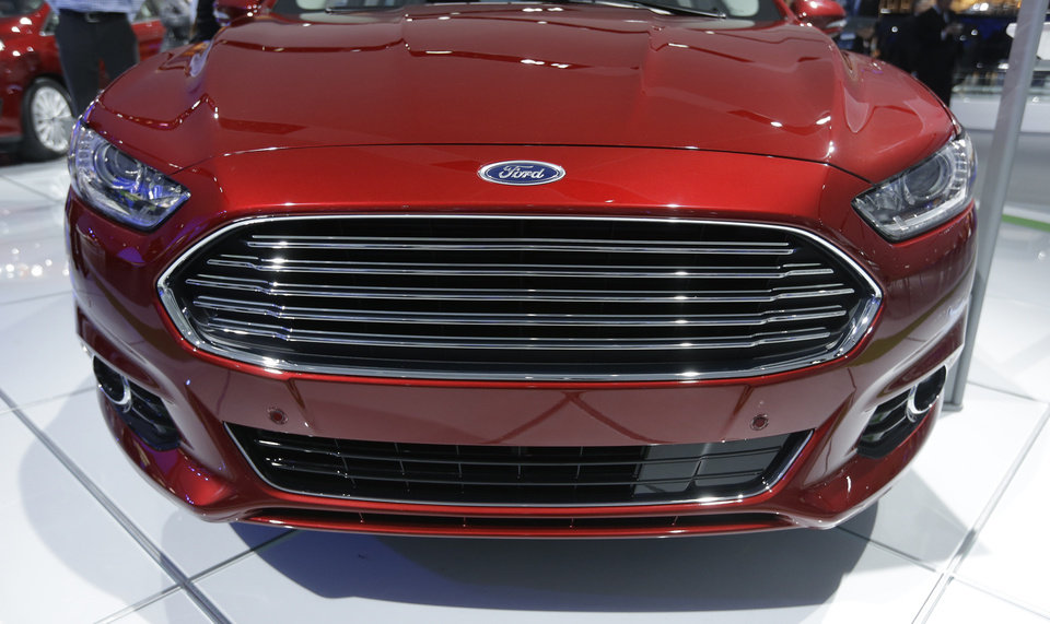 The front grill of the 2014 Ford Fusion is displayed at the North American International Auto Show in Detroit, Tuesday, Jan. 15, 2013. (AP Photo/Carlos Osorio)