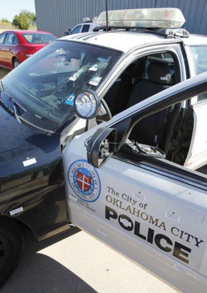 Photo - This is the police car of the Oklahoma City Police officer who was ambushed and shot multiple times after a Sunday night traffic stop.  The white stickers show where the bullets entered the vehicle. By Paul Hellstern, The Oklahoman ORG XMIT: KOD  PAUL HELLSTERN
