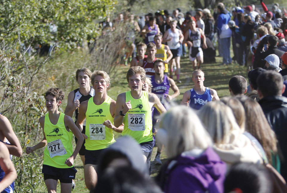 The Heritage Hall team passes by during the Boys 4A State Cross Country Finals at Edmond Santa Fe High School in Edmond, OK, Saturday, October 27, 2012,  By Paul Hellstern, The Oklahoman