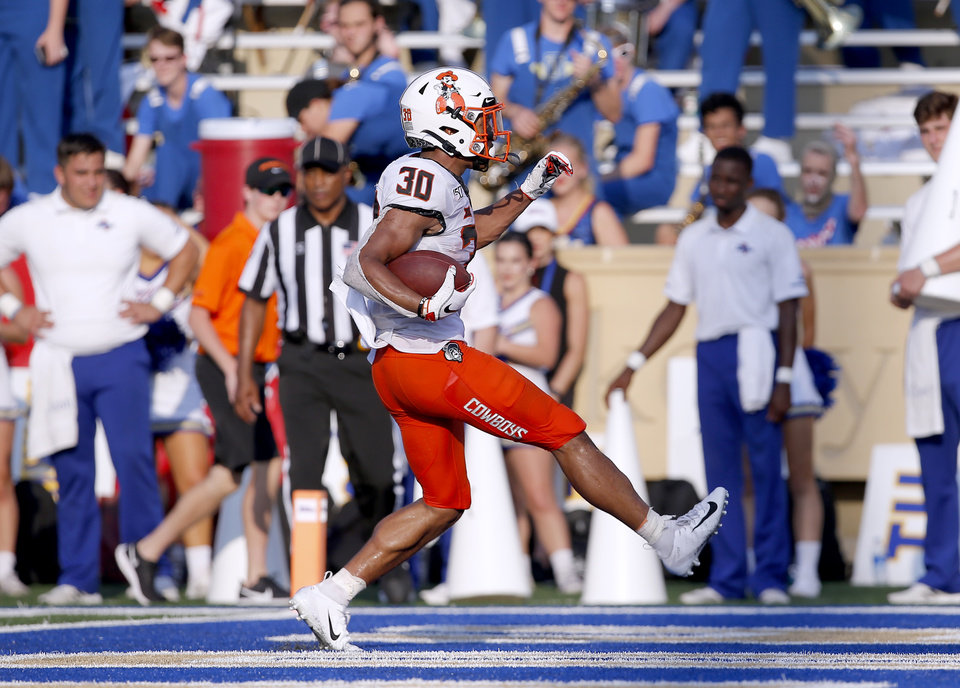 Photo - Oklahoma State's Chuba Hubbard (30) scores a touchdown in the fourth quarter during a college football game between the Oklahoma State University Cowboys (OSU) and the University of Tulsa Golden Hurricane (TU) at H.A. Chapman Stadium in Tulsa, Okla., Saturday, Sept. 14, 2019. [Sarah Phipps/The Oklahoman]