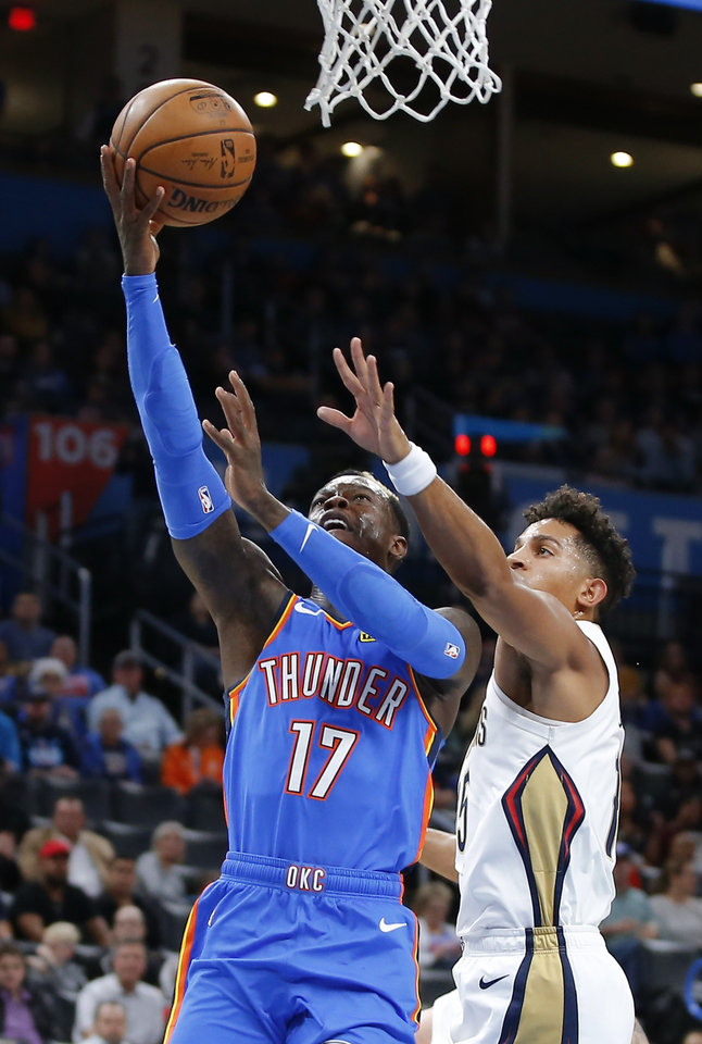 Photo - Oklahoma City's Dennis Schroder (17) goes past New Orleans' Frank Jackson (15) during an NBA basketball game between the Oklahoma City Thunder and the New Orleans Pelicans at Chesapeake Energy Arena in Oklahoma City, Saturday, Nov. 2, 2019.  [Bryan Terry/The Oklahoman]