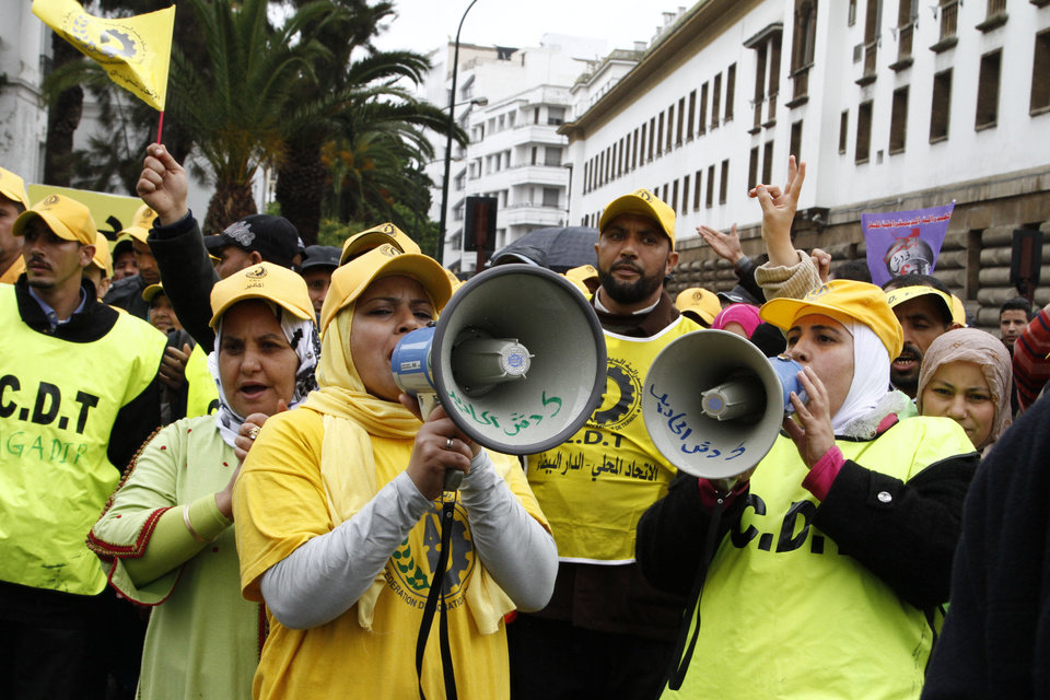 Moroccan women union activists chant slogans through loud speakers bearing the name of their CDT union in Arabic. Thousands of labor union activists marched through Morocco\'s capital Rabat on Sunday March 31, 2013 calling for the fall of the government because of its failure to address unemployment and rising prices.(AP Photo/Paul Schemm)