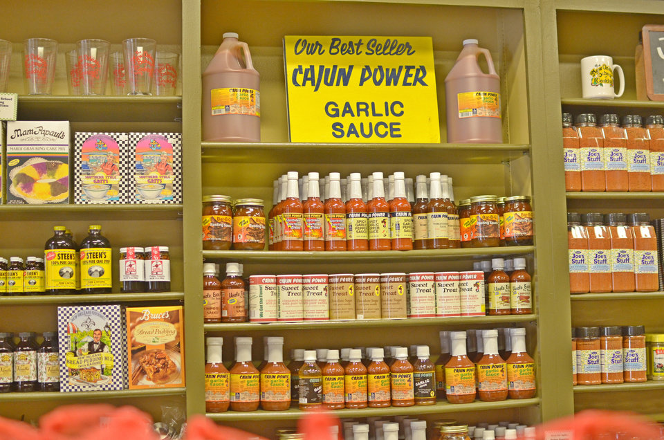 Photo - The Louisiana General Store, part of the New Orleans School of Cooking, sells Cajun spices and sauces. PHOTO BY WESLEY K.H. TEO, FOR THE OKLAHOMAN