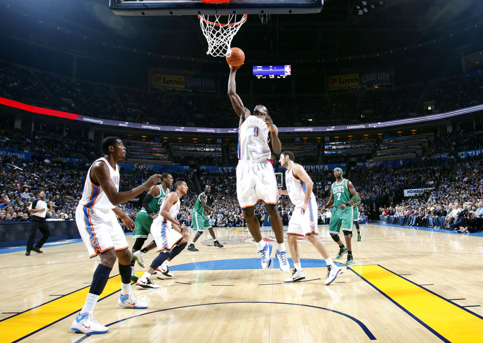 Photo - Oklahoma City's Serge Ibaka grabs a rebound during the NBA game between the Oklahoma City Thunder and the Boston Celtics, Sunday, Nov. 7, 2010, at the Oklahoma City Arena. Photo by Sarah Phipps, The Oklahoman