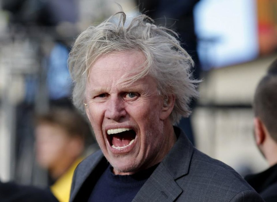 Photo - Actor Gary Busey cheers from the sidelines during a college football game between Oklahoma State and West Virginia at Boone Pickens Stadium in Stillwater, Okla., Saturday, Nov. 17, 2018. [Sarah Phipps/The Oklahoman Archives]